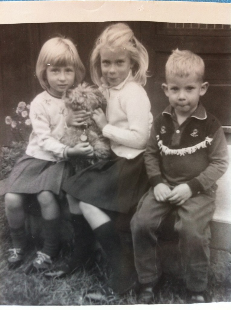 My siblings and I with our beloved childhood dog, Poppy.