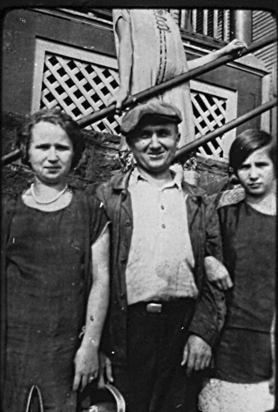 My grandmother as a young girl on the right, standing with her older sister Ann, and her father, John.