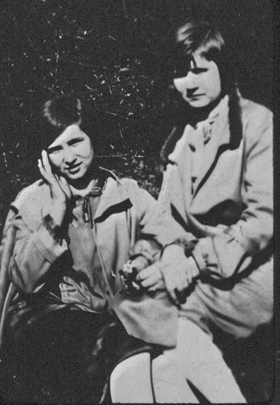 My grandmother is on the left, and I love how delicately she is holding her hair back with her hand.