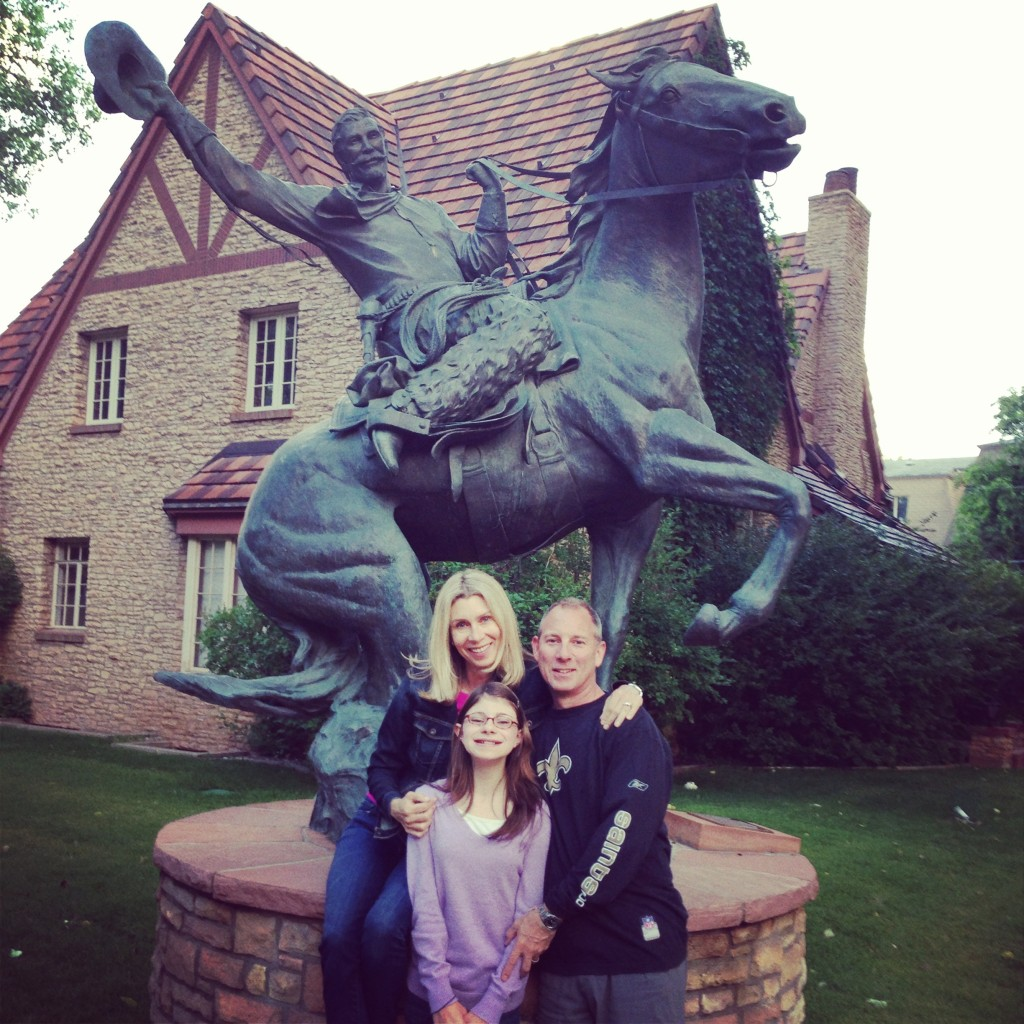 """Me, my beautiful niece and by favorite brother in front of the University of Wyoming """"Cowboy."""""""